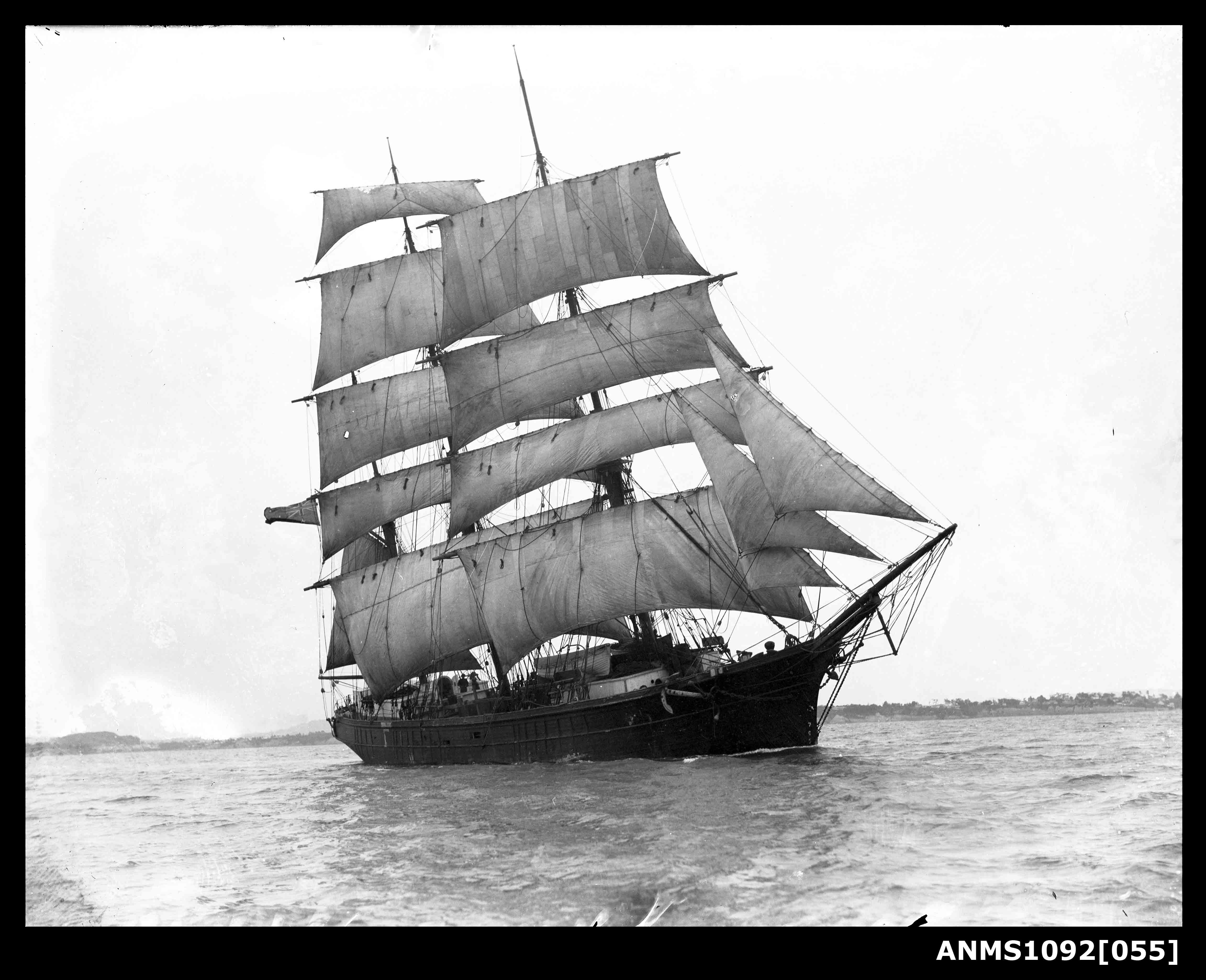 Three-masted barque underway with sails set, possibly Sydney Harbour