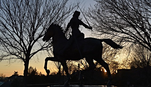 meridianhillpark joanofarc saintjoanofarc saintjoan sculpture statue pauldubois 1922 jeannedarc liberty liberator france french meridianhill park malcolmxpark robertpetershill landscape architecture georgeburnap 15thstreet washingtondc dc districtofcolumbia city street outdoor equestrain saint knight armor horse sword trees skyline golden light sunset columbiaheights medieval war military sunlight shadow silhouette black blue orange sky cityscape scenic