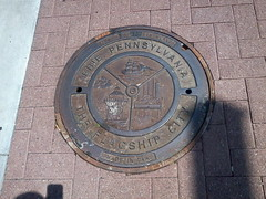 commemorative plaque, iron, manhole cover, circle,
