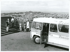 Tourists viewing the suburbs of Auckland and One Tree Hill from the summit of Mt Eden