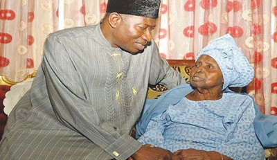 Federal Republic of Nigeria President Goodluck Jonathan consoles the mother of Nigerian publisher of the Tribune Hannah Dideolu Awolowo. by Pan-African News Wire File Photos