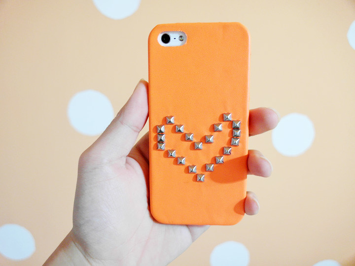 orange iphone cover with studs