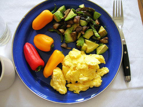 scrambled eggs and mini peppers with avocado, mushroom, and jalapeno hash