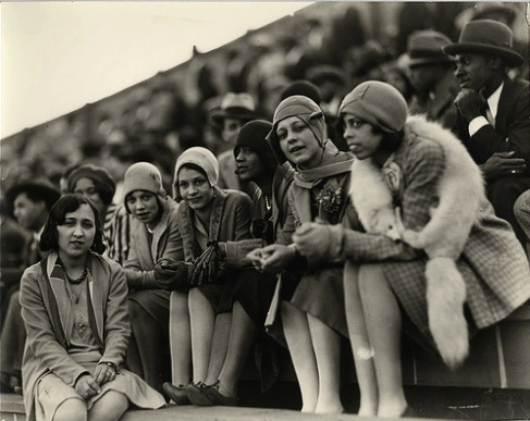 Flappers of different races at a football came