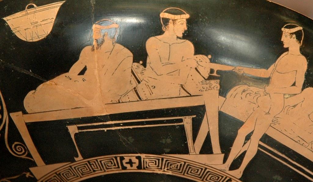 Sirviendo vino en un banquete. Copa de cerámica griega. 450 a.C.