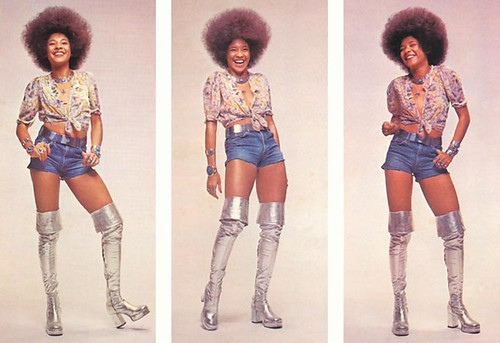 Betty Davis wearing thigh-high boots and short shors