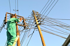 An electricity pylon in Somaliland being repaired by Edwin Mireri. Somaliland's first Electricity Energy Act will be launched this year and it will be the country's first legal and regulatory framework aimed at managing energy production and distribution.