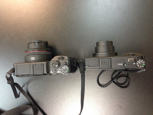 The GRD IV on the right is much smaller and more portable, but with a small sensor. The new Ricoh GR promises the big sensor in a similar sized body.