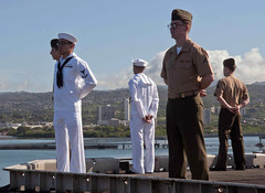 Sailors and Marines assigned to amphibious assault ship USS Peleliu (LHA 5) man the rails as the ship arrives in Pearl Harbor for a port visit, May 3. (U.S. Navy photo by Mass Communication Specialist 3rd Class Derek Stroop)