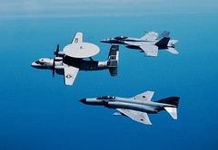 An E-2C Hawkeye from VAW-115, an F/A-18E Super Hornet from VFA-195, and an F-4EJ Phantom II fighter from the JASDF's 302nd Tactical Fighter Squadron fly in formation as part of the second Benkyoukai training exercise. (U.S. Navy/Cmdr. Guy Snodgrass)