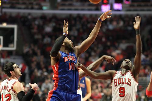 Detroit Piston Greg Monroe and Chicago Bull Luol Deng go up for the rebound