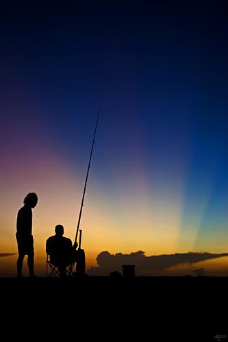 light sunset colour beach silhouette backlight fishing fisherman colours spectrum guadeloupe grandanse