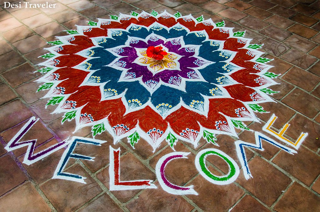 A Floral Rangoli with Welcome written
