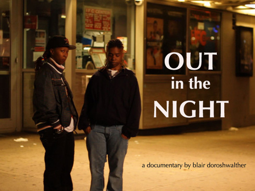 A still from the movie Out in the Night, which features two young black  women standing on a street corner. The name of the film is written in white