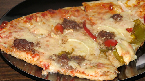 Hamburger, pepper, and onion pizza by Coyoty