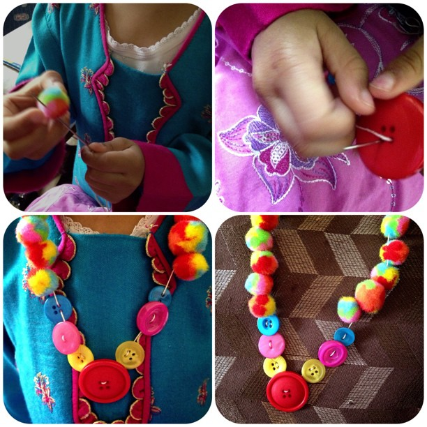 We made a Pom Pom and button necklace, my niece really enjoyed it and it was so easy for her to do #pompom #niece #buttons #rainbow #craft #child