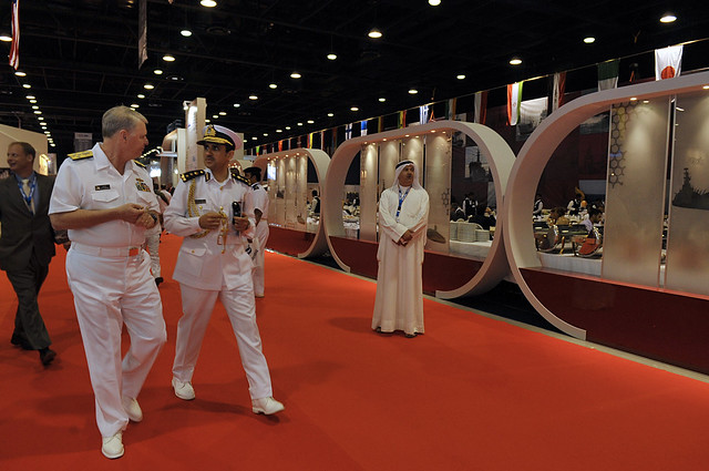 Qatari Emiri liason officer Col. Abdullah Eid Al-Bourdaini, left, speaks about the Qatar coast guard with Chief of Naval Operations Adm. Gary Roughead during DIMDEX 2010 - U.S. Navy photo by Mass Communication Specialist 1st Class Tiffini Jones Vanderwyst
