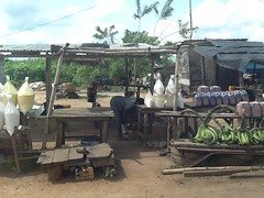 Green plantains, gari and palm oil roadside market, Ondo, Nigeria. #JujuFilms