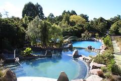 backyard(0.0), leisure(0.0), estate(0.0), villa(0.0), water park(0.0), park(0.0), resort town(1.0), swimming pool(1.0), property(1.0), reflecting pool(1.0), resort(1.0),