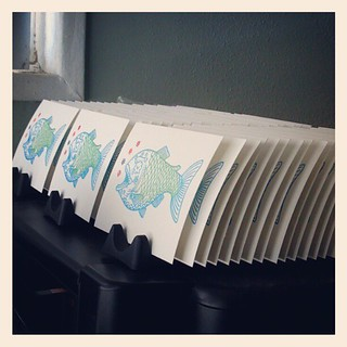 Freshly printed #gocco prints drying on the racks.