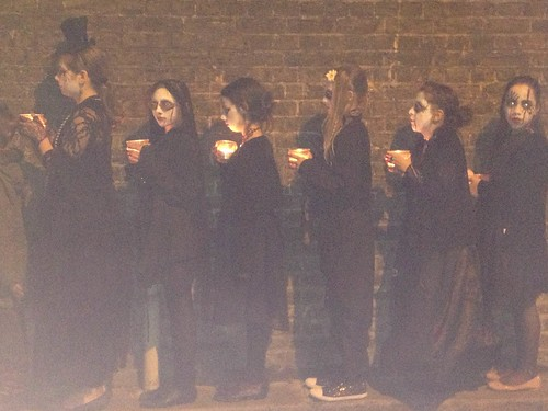 Candlelit procession on brick wall