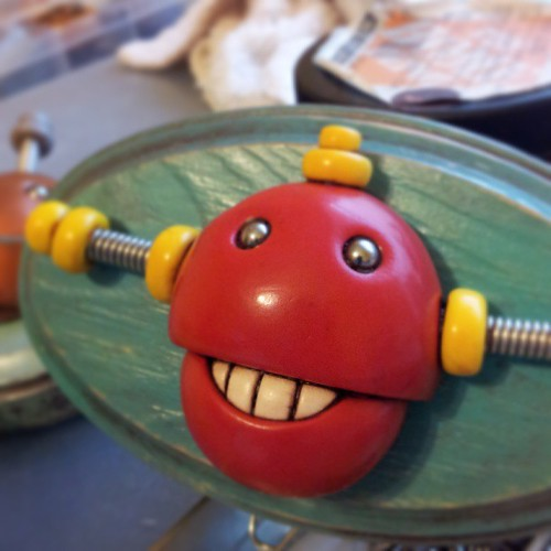 Sneak peek: this smiley robot available soon to hang on your wall. by HerArtSheLoves