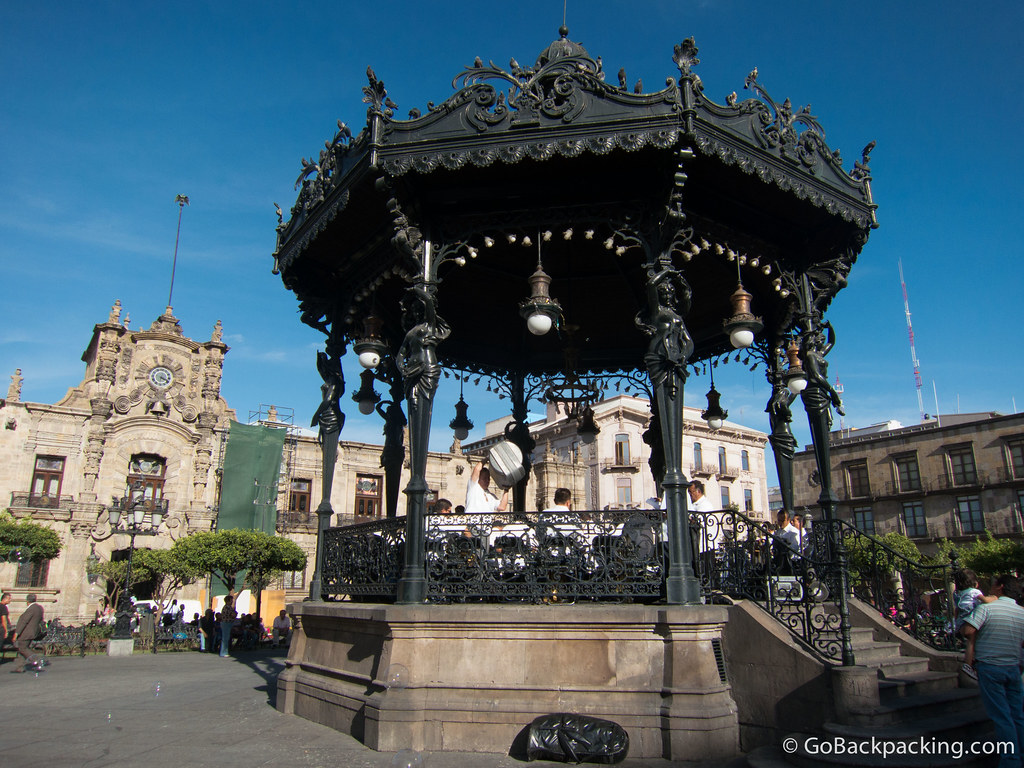 A French bandstand in the middle of the Plaza de Armas, east of the Cathedral. The Palacio de Gobierno (Governor's Palace) can be seen in the back left.