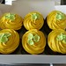 Yellow coloured pipped cupcakes