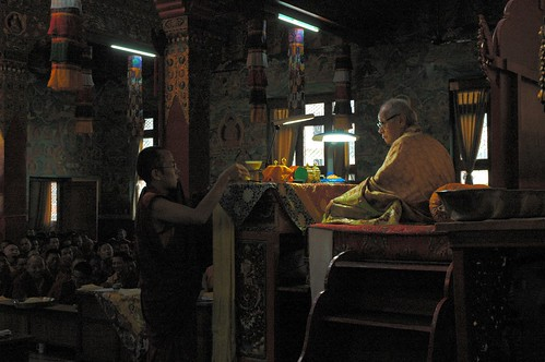 Master of Ceremonies serving senior Tibetan Lama His Holiness Dagchen Sakya tea and dharma muffin, sangha, Sakya Lamdre, Tharlam Monastery, Boudha, Kathmandu, Nepal by Wonderlane