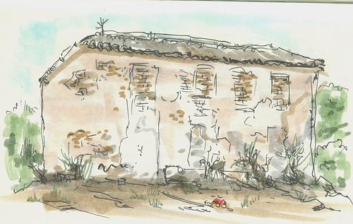 Dibujo de una casa abandonada en una aldea