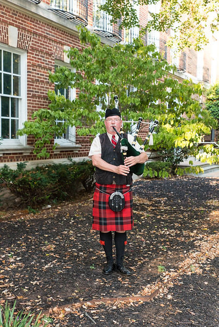 Bagpiper welcoming guests
