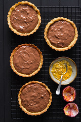Passion fruit and milk chocolate mini tarts