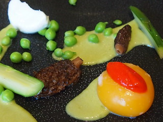 Detail: Broken duck's egg, green asparagus, green peas, fresh morels, red bell pepper