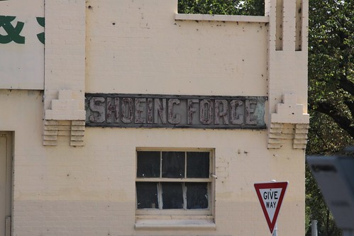 'Wheelwright' and 'Shoeing Forge' signs on the facade