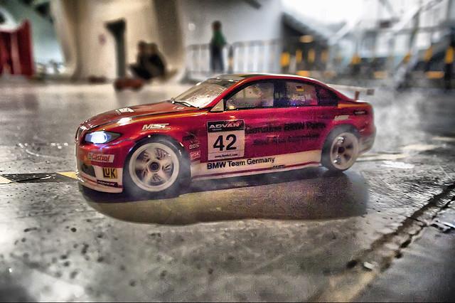 A drifting electric model car, 口K Exhibition, Shenzhen, China. Nikon D700 + Sigma 24-70/2.8D HDR + PS.