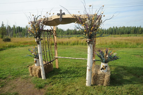 Wedding arch, Christian cross, white birch, dried flowers, hay, grass field, spruce trees, Jessie & Chris wedding, Fairbanks, Alaska, USA by Wonderlane