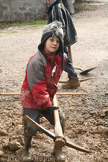A young boy with a pick ax