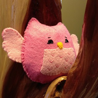 Pink felt baby rattle hand stitched by #OneSweetStitch with pattern by #Noialand. Sweet owl has crinkle noise and rattle inside. #felt #plush #baby #toy #owl
