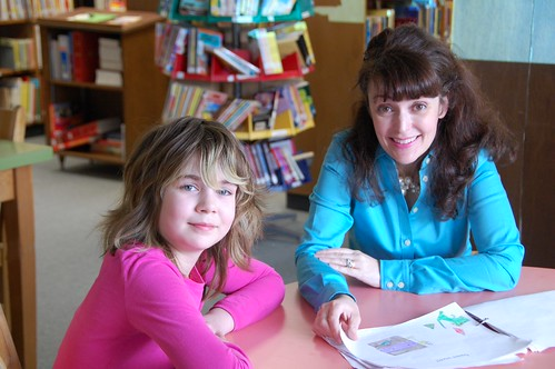 Victoria Miles with a budding writer at Kildala Elementary in Kitimat