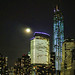 Cloud Shrouded Full Moon By 1 World Trade Center - Water View by NYCisMyMuse