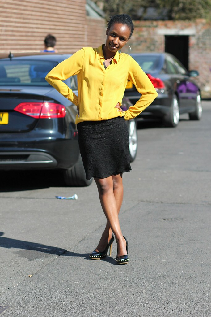 Yellow Blouse, black lace skirt, studded heels & a trench coat, yellow long sleeved top, yellow blouse,lace skirt, black heels,black lace mini skirt, pencil skirt, pattern pencil skirt, red pants, red trousers, red corduroy pants, red corduroy trousers, black blazer with brown lining lapels, black studded heels, black heels, khaki strappy sandals with yellow sole, sandals with yellow sole, ways of wearing the same top, one top four ways of styling it