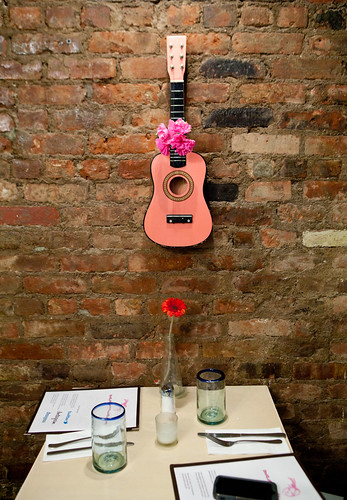 Small pink guitar on the wall