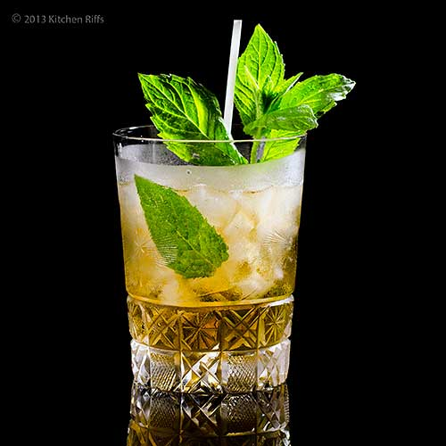Mint Julep Cocktail in Crystal Glass with Mint and Straw Garnish