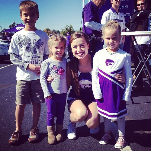 We bleed purple now...kids excited to find a K-State cheerleader at tailgate!
