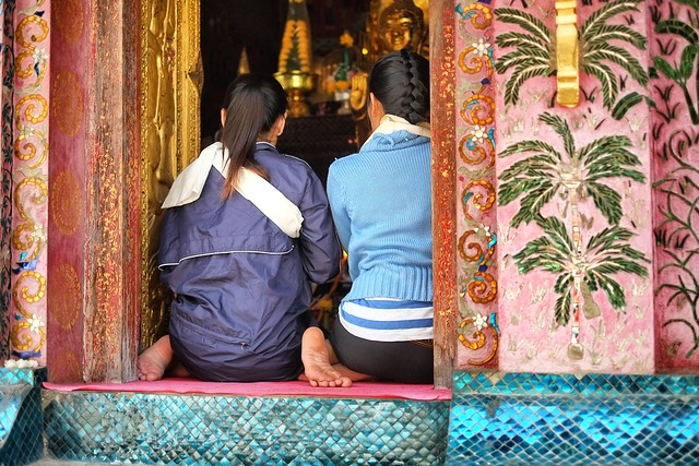 Praying at Wat Xieng Thong, Luang Prabang, Laos.