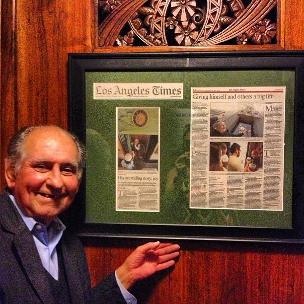 Meet Ruben Pardo, who's been operating this 1929 mahogany elevator for over 35 years.