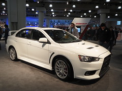 sports car(0.0), automobile(1.0), automotive exterior(1.0), wheel(1.0), vehicle(1.0), automotive design(1.0), auto show(1.0), full-size car(1.0), mitsubishi(1.0), bumper(1.0), mitsubishi lancer evolution(1.0), sedan(1.0), land vehicle(1.0), luxury vehicle(1.0),