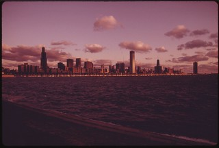Sunrise On Lake Michigan With Chicago Shown In The Background. The City Has Provided A Climate For Developing Black Resources And Is Considered The Black Business Capital Of The United States, 03/1974