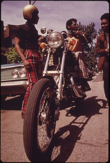 Black Residents Of Chicago's West Side Check Out A Motorcycle. The City's West Side Did Not Quickly Recover From The Riots And Fires Of The Mid And Late 1960's, 06/1973