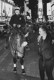 Officer, police horse, and an animal lover in Times Square, NYC